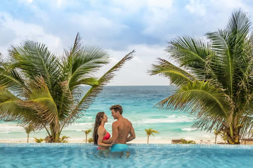 Couple in pool overlooking the beach
