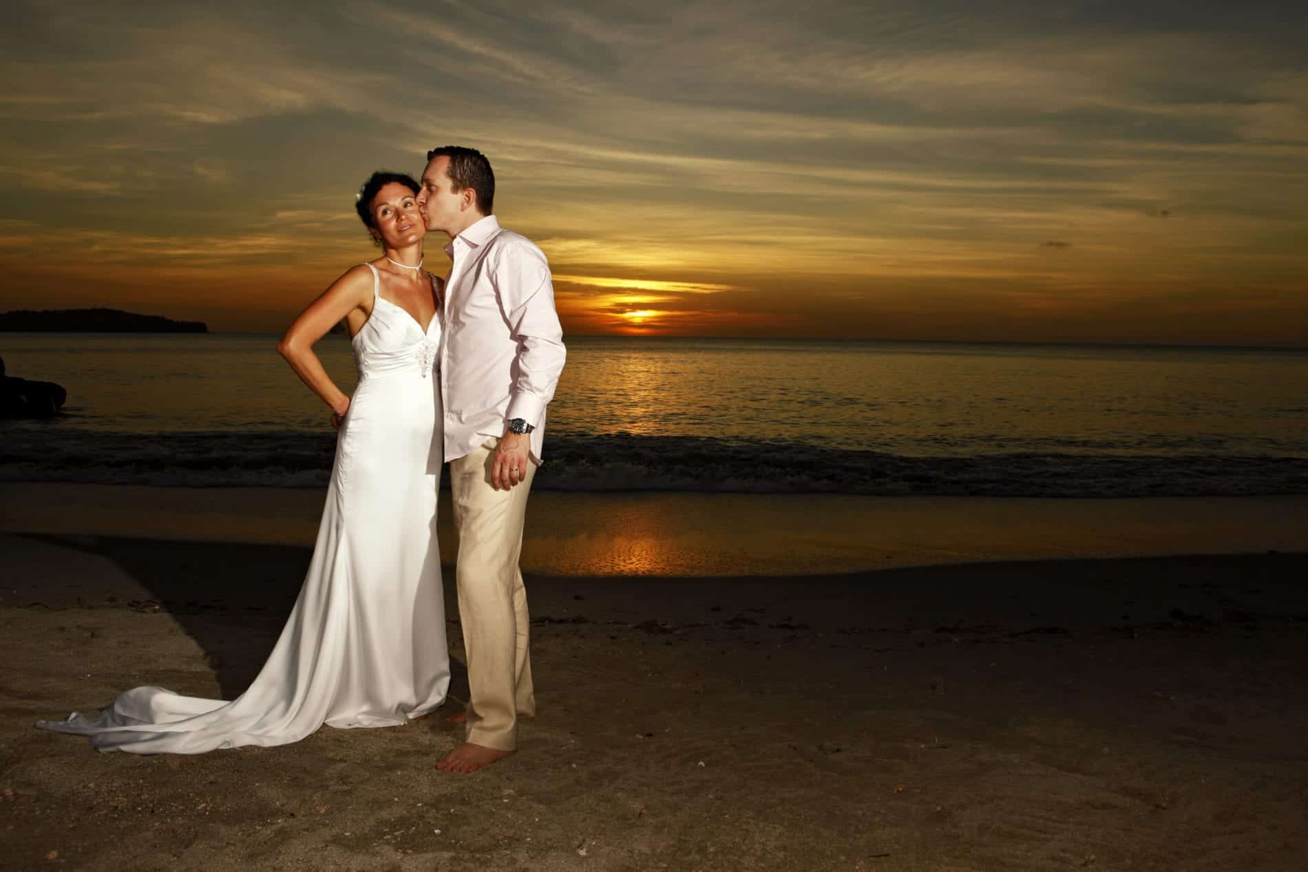 Destination wedding couple at sunset