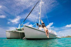 Tropical Vacation: Man Diving Off Sailboat
