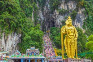 The Batu Caves Lord Murugan Statue and entrance near Kuala Lumpur Malaysia. A limestone outcrop located just north of Kuala Lumpur, Batu Caves has three main caves featuring temples and Hindu shrines. (The Batu Caves Lord Murugan Statue and entrance n