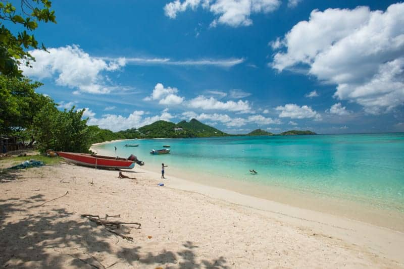 Fly to Grenada in teh Caribbean for gorgeous beaches like these on Carriacou Island