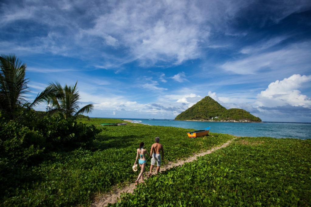 Couple walking Levera Beach - Grenada