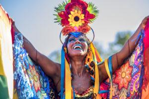 Rio de Janeiro, Brazil - February 9, 2016: Beautiful Brazilian woman of African descent wearing colourful costume and smiling during Carnaval 2016 in Rio de Janeiro, Brazil.