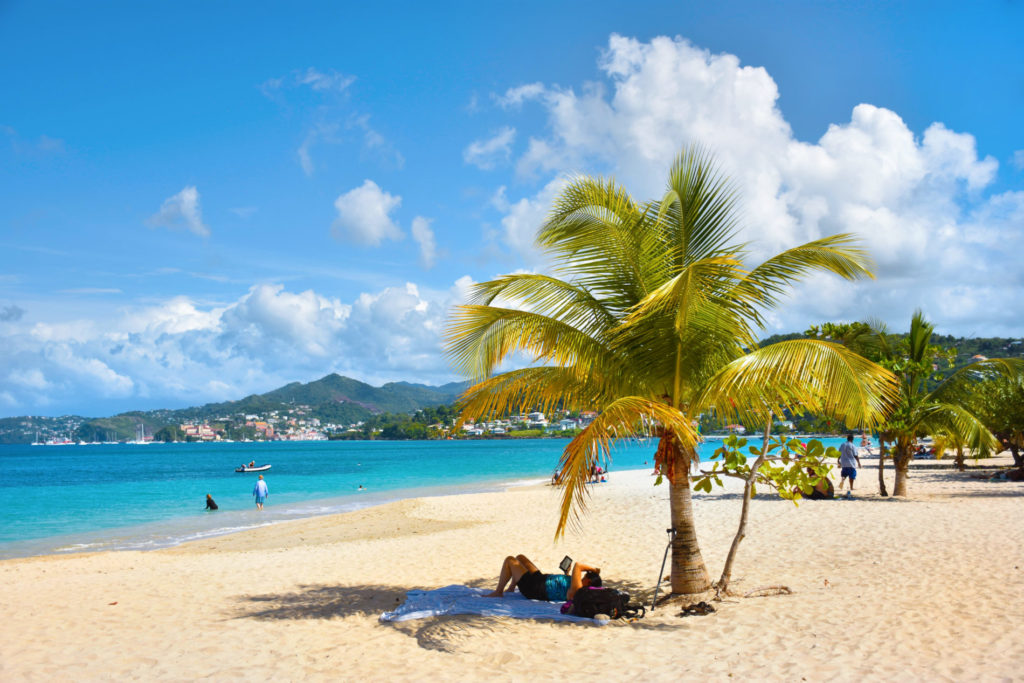 relaxing on Grand Anse beach - Grenada holidays