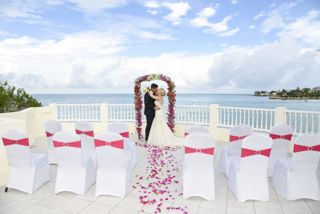 Wedding abroad with bride and groom at a beach wedding