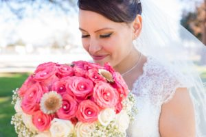Bride with flowers before her wedding by the beach