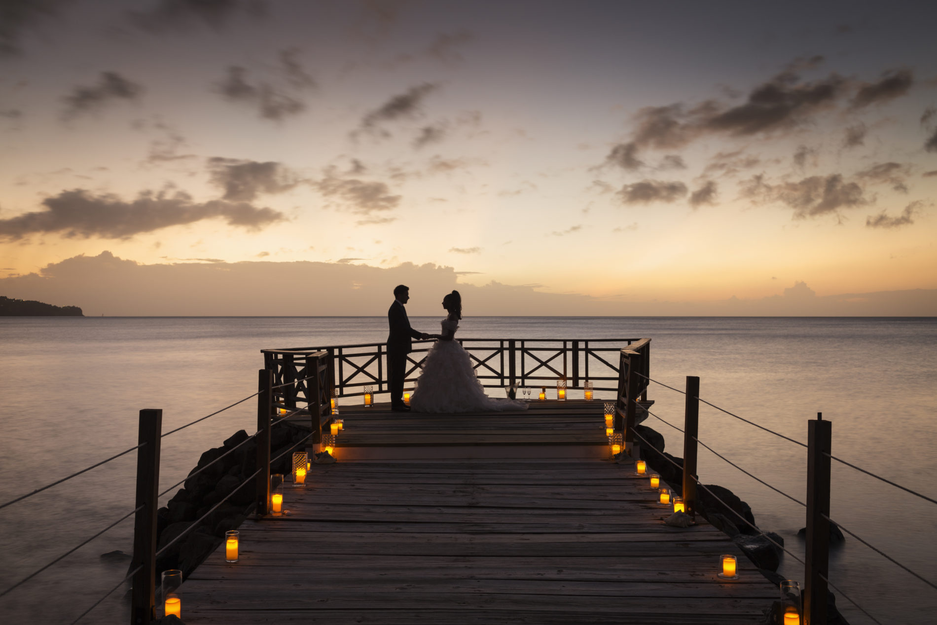 A couple getting married abroad at sunset