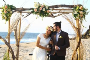 A beautiful wedding abroad with bride and groom on beach